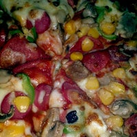 Photo taken at Domino's Pizza by Yusuf T. on 12/28/2012