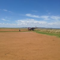 Photo taken at Masai Mara Airstrip by Serkan Y. on 10/3/2013