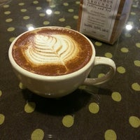 Photo taken at Uncommon Grounds Coffee & Tea by Ben H. on 2/26/2013