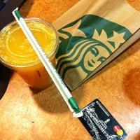 Photo taken at Starbucks by Polina K. on 2/23/2013