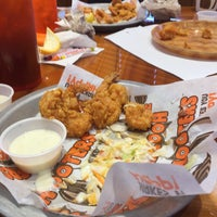 Photo taken at Hooters by Denisse P. on 10/11/2015