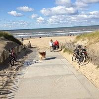 Photo taken at Strand Noordwijk aan Zee by Ivo B. on 10/7/2012