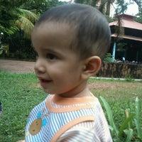 Photo taken at Changampuzha Park by Girish V. on 9/18/2014