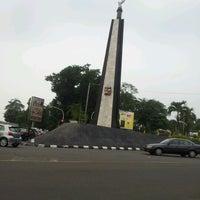 Photo taken at Tugu Kujang Bogor by Ayu S. on 10/25/2012