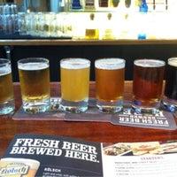 Photo taken at Rock Bottom Restaurant & Brewery by Cindiasaurus R. on 5/12/2013