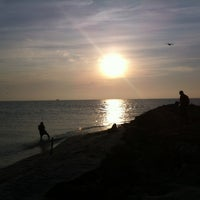 Photo taken at Captiva beach by Eryka J. on 11/28/2012