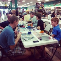 Photo taken at Dragon's Lair Comics by Alachia Q. on 8/10/2014