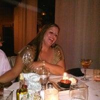 Photo taken at Mezza Restaurant & Bar by Caitlin M. on 11/24/2012