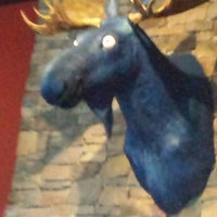 Photo taken at The Blue Moose Bar & Grill by Julia N. on 8/1/2014
