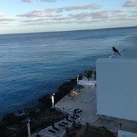 Photo taken at Coral Princess Golf & Dive Resort by Carlos L. on 12/23/2012