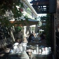 Photo taken at Va de Vi Bistro & Wine Bar by Aaron C. on 9/28/2012