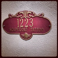 Photo taken at Scapegoat Tattoo by Eddie D. on 3/4/2013