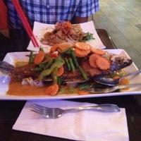 Photo taken at Udom Thai Restaurant & Bar by Sonnett S. on 10/5/2013