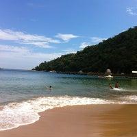 Photo taken at Praia de Laranjeiras by Matheus C. on 12/16/2012
