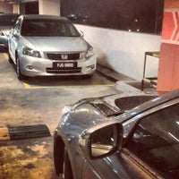 Photo taken at Queensbay Multilevel Carpark by Ryan L. on 12/12/2012
