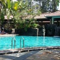 Photo taken at Melia Purosani Swimming Pool by Suyanto T. on 6/25/2014
