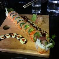Photo taken at Sushi Dokku by Allison S. on 3/29/2013