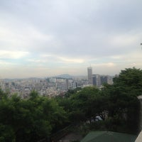 Photo taken at Naksan Park by Jeonkyung on 6/16/2013