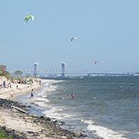 Photo taken at Plumb Beach by Edi E. on 4/15/2013