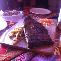 Photo taken at La Cabaña smoked ribs by Luis E. on 1/12/2014