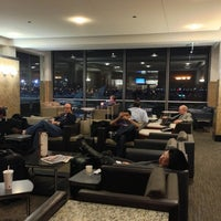 Photo taken at American Airlines Admirals Club by Melanie N. on 12/21/2012
