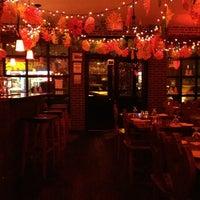 Photo taken at La Taverna Bar & Restaurant by Dulce Helena Melchiori N. on 1/11/2013