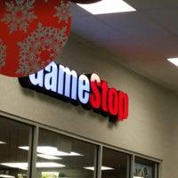Photo taken at GameStop by Carolyn C. on 12/21/2013
