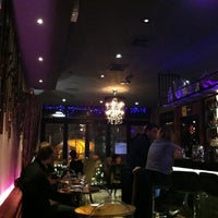Photo taken at Uncorked Bar & Grill by Cat on 1/13/2013