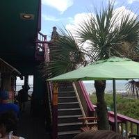 Photo taken at Coconut Joe's Beach Grill by Alex B. on 7/27/2013