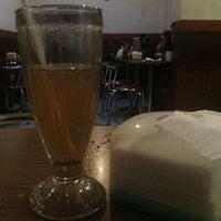 Photo taken at GUSTO Café n` Resto by Jamaludin N. on 1/8/2013