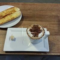 Photo taken at Le Petit Cafe by Davi M. on 1/9/2014