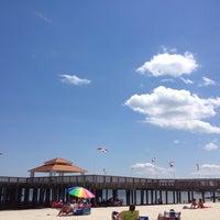Photo taken at Buckroe Beach by Lewis S. on 8/4/2013