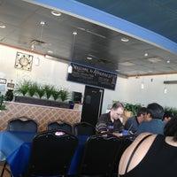 Photo taken at Atheneos Greek Village Cafe by Maclaine C. on 7/19/2013