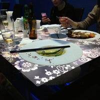Photo taken at Oshi Asian Interactive restaurant by Андрей З. on 2/3/2013