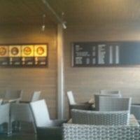 Photo taken at Domyno Burger Bar by Sam E. on 11/25/2012