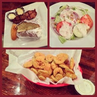 Photo taken at 13 Bones - Ribs - Seafood - Steak by Tracy B. on 10/10/2012