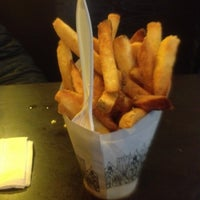 Photo taken at Pommes Frites by Lauren on 2/20/2013