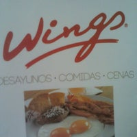 Photo taken at Wings by Mariana G. on 1/26/2013