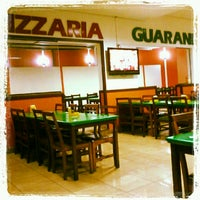 Photo taken at Pizzaria Guarani by Helen L. on 10/11/2012