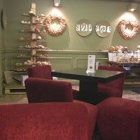 Photo taken at Caramel Cafe by Anna M. on 12/21/2012