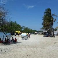 Photo taken at Playa El Oasis by Alfonzo S. on 10/4/2015