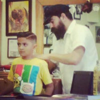 Photo taken at Stay Gold Barber Shop by Mitchelle L. on 3/18/2013
