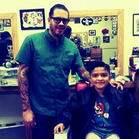 Photo taken at Stay Gold Barber Shop by Mitchelle L. on 3/12/2013