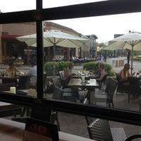 Photo taken at CRAVE American Kitchen & Sushi Bar by Bridget B. on 7/15/2013