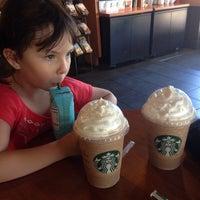 Photo taken at Starbucks by Edna C. on 4/10/2014