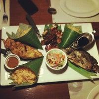 Photo taken at Grilla Bar and Grill by jun n. on 1/11/2013