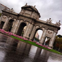 Photo taken at Alcalá Gate by Elysasg on 10/21/2012