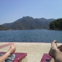 Photo taken at Marmaris Park Beach by Rik V. on 8/9/2013