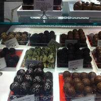 Photo taken at Godiva Chocolatier by Heather B. on 12/29/2012