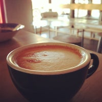 Photo taken at Cartel Coffee Lab by Uber P. on 4/26/2013